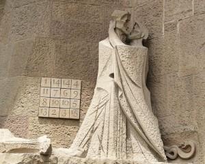 Bibelmotiv mit nebenstehendem Kryptogramm: Judas küsst Jesus. Doch was bedeuten die Zahlen?
